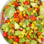 Plate of summer chopped salad tossed in creamy herb dressing
