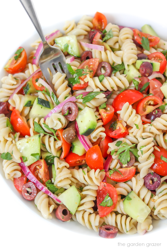 Vegan Italian Pasta Salad in a white bowl with fork