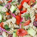 Vegan Pasta Salad in a bowl with tomatoes and cucumber