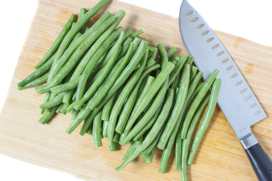 Fresh trimmed green beans on a cutting board