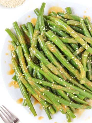 Plate of miso-glazed green beans with sesame seeds