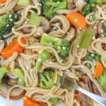 Plate of teriyaki noodle with vegetables