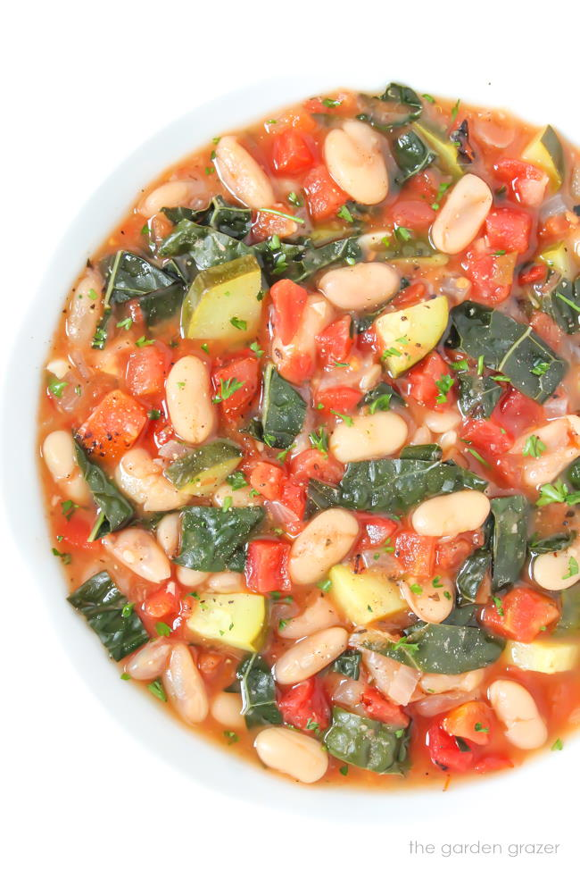 Vegan tomato white bean soup with kale in a bowl