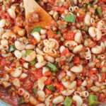 Skillet of vegan American goulash with lentils and mushrooms