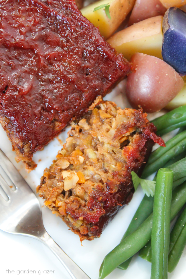 Sliced vegan lentil loaf on a plate