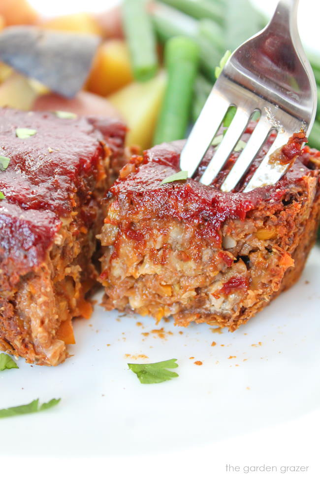 Vegan mini meatloaf on a plate with fork