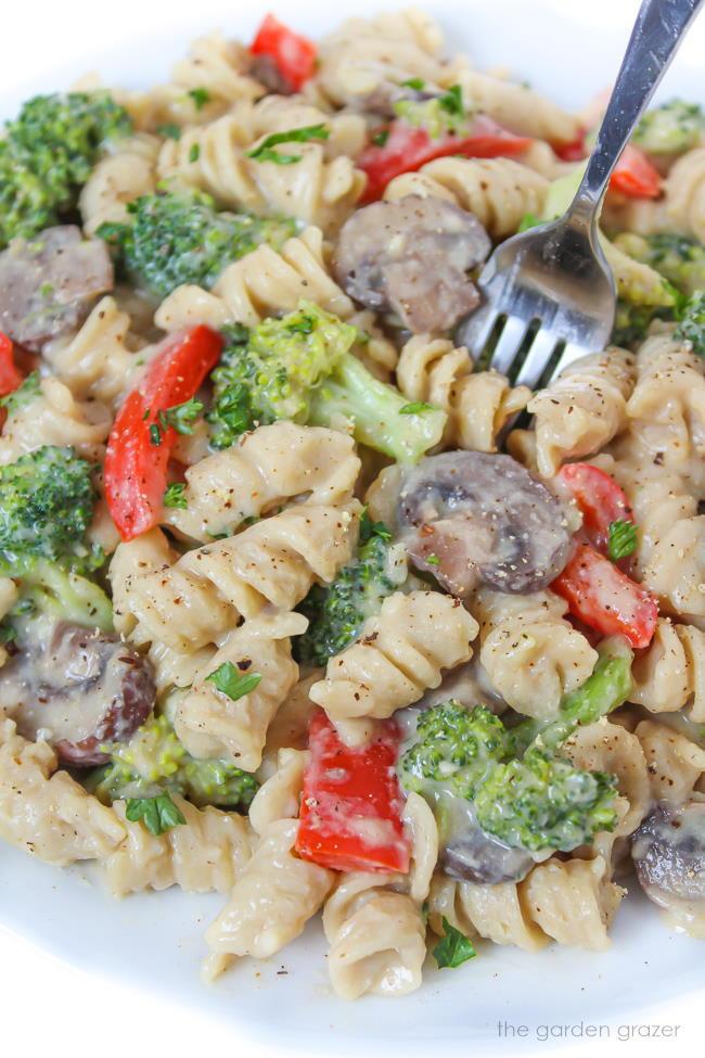 Vegan creamy garlic pasta with broccoli on a plate