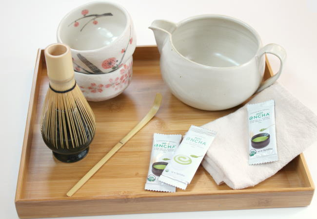 A bamboo tray with matcha set essentials