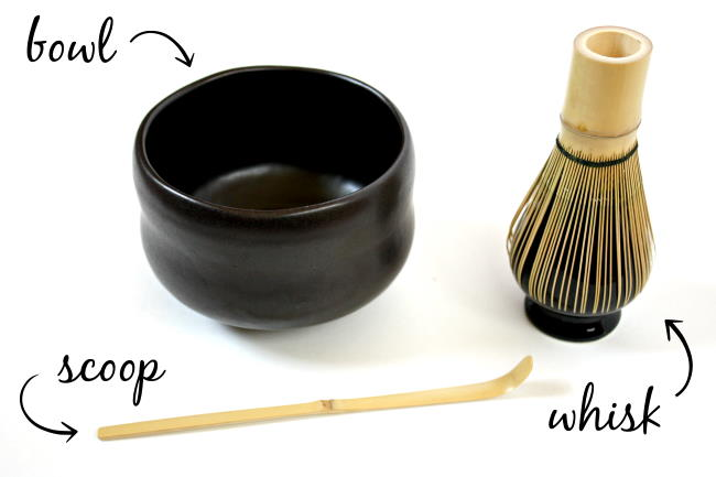 Tools needed for whisking matcha, including a bowl, scoop, and bamboo whisk