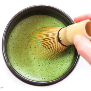 Whisking a hot bowl of matcha green tea