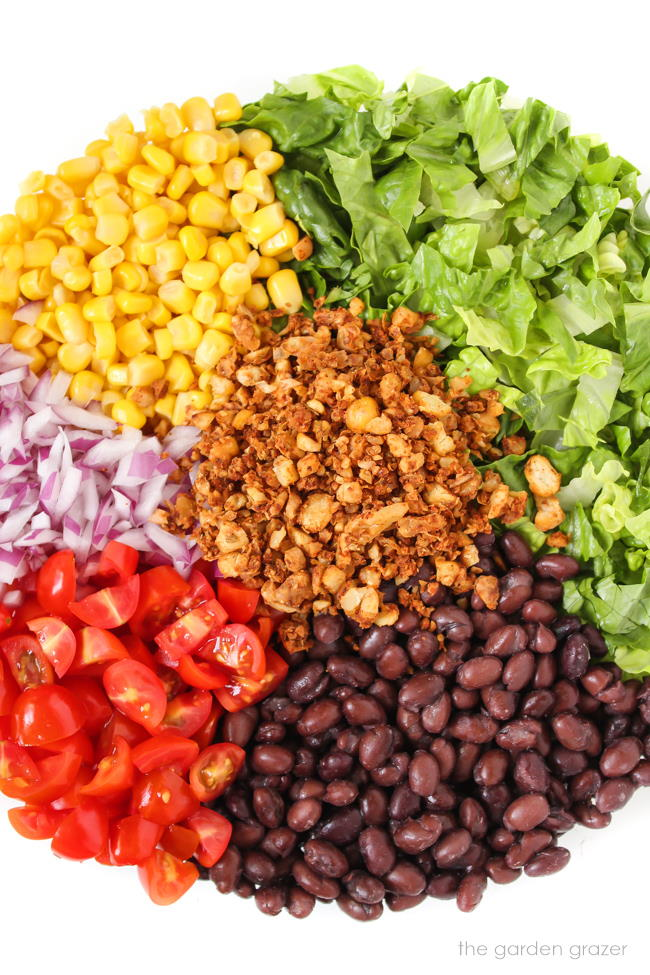 Ingredients in a white bowl for vegan taco salad