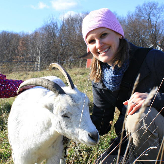 Kaitlin with goat at Heartland Farm Sanctuary in Madison Wisconsin
