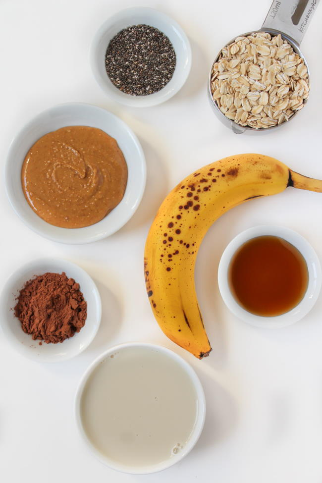 Ingredients spread out on a white table for overnight oats
